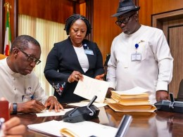 Delta State Governor, Senator Ifeanyi Okowa (left); Speaker, Delta State House of Assembly, Rt. Hon. Sheriff Oborevwori (right) and Clerk of the House, Barr. (Mrs.) Lyna Ocholor, during the Signing into law of 6 Bills Passed by the State House of Assembly.