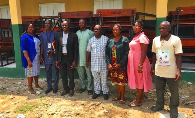 Hon Peter Uviejitobor (middle) during the Distribution of the SchoolFurnitures
