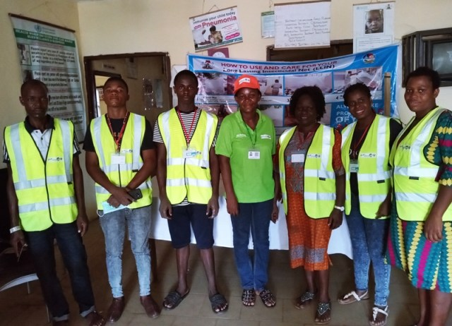 Umuagu Primary Health Centre LLINS Distribution Point supervisor, Mrs Gloria Anene flanked by her team members