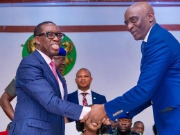 Delta State Governor, Senator (Dr) Ifeanyi Okowa (left), congratulating Barr. Chiedu Ebie, after swearing him in as the new Secretary to Government in Asaba.