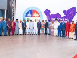 Governor Okowa flanked by newly sworn-in Commissioner Designates at Event Centre Asaba.