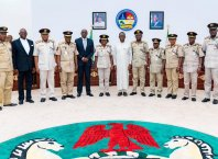 Delta State Governor, Senator Ifeanyi Okowa (6th right); Secretary to State Government, Mr. Chiedu Ebie (5th left); the Comptroller General of the Nigeria Immigration Service, Mohammad Babandede (5th right) and Others, during a courtesy call on the Governor, by the Comptroller General at Government House Asaba.