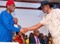 Delta state Governor, Senator Ifeanyi Okowa (left); congratulating Prof. Patrick Muoboghare, after been sworn-in as Commissioner to the Governor, in Government House Asaba, on July 3, 2019