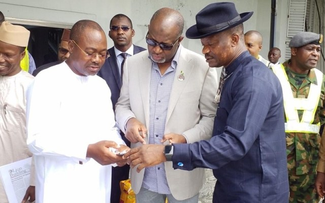 Minister For Aviation, Sen Hadi Sirika (Centre), Prof. Slyvester Monye (Right), Mr. Charles Aniagwu, Commissioner For Information (Left)  In A Discussion During The Minister's Inspection Visit To Asaba Airport.