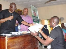 Rt. Hon Ndudi Elumelu, Minority leader of the Federal House of Representatives and member representing Aniocha/Oshimili Federal Constituency Issuing Appointment Letter to a Personal Assistant