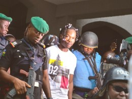 Nigeria Music Artiste Afeez Adesina Fashola, AKA Naira Marley being led of Court Room in May 2019