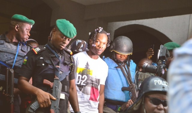 Nigeria Music Artiste Afeez Adesina Fashola, AKA Naira Marley being led of Court Room in May 2019