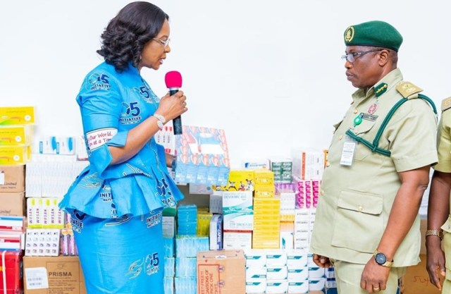 L-R: Wife of Delta Governor, Dame Edith Okowa presenting Medications meant for Inmates to the the State Controller of the Nigerian Correctional Service, Mr Sam Iyakoregha at Government House, Asaba