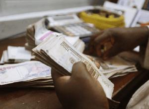 Illustration Photo: Man Counting Money