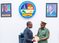Delta State Governor ,Senator Dr Ifeanyi Okowa (left),receiving a plague from the Director General, NYSC Brigadier.General Shuaibu Ibrahim during a courtesy call by the latter in Government House, Asaba. Wednesday, February 5, 2020