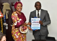 The Director-General of the National Agency for the Prohibition of Trafficking in Persons, Dame Julie Okah-Donli presenting a souvenir to the Chairman of the Delta State Task Force on Human Trafficking and Irregular Migration, Mr. Peter Mrakpor after an interactive session between the Agency and the Task Force on Monday, March 16, 2020 in Asaba