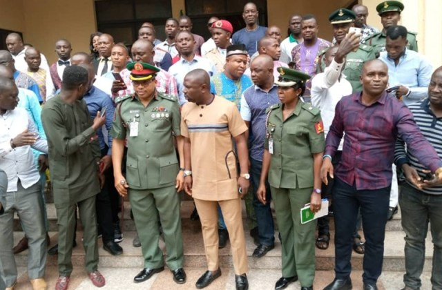 Brig. Gen. Emmanuel Akpan flanked by Delta Youths after the recruitment sensitization in Delta State at Government House Asaba.