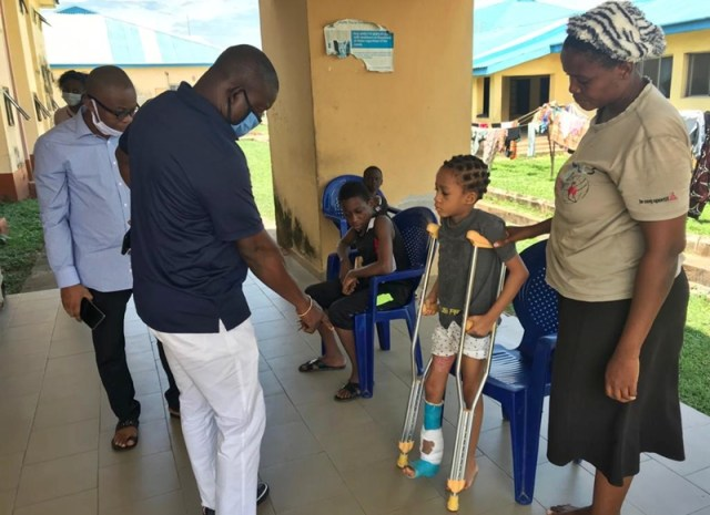 Hon Festus Okoh (left) with Little Miss Glory Roland at the Children Ward in FMC Asaba before her discharge.