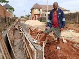 Dr. Sunday Okonji, philanthropist building 700 metres drainage in Okpanam Community in Delta State