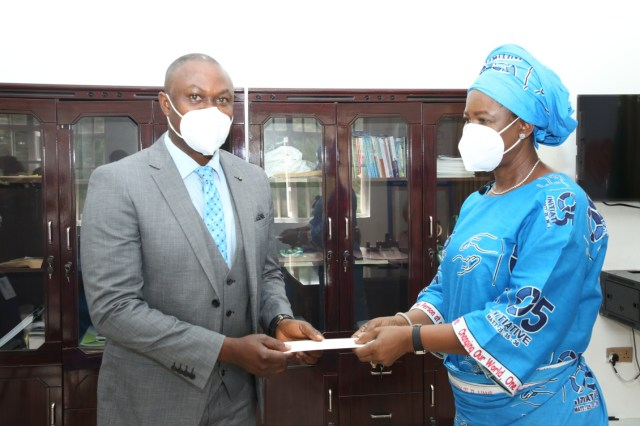 Dame Edith Okowa (right) presenting a cheque of three million four hundred and thirty three thousand naira to the Chief Medical Director, Federal medical Centre, Asaba, Dr. Victor Osiatuma as payment of medical bills for 13 patients at the Hospital in continuation of the activities to mark the 2020 world charity day celebration.