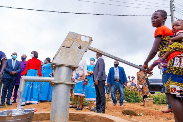 A Mile 5 resident pumping out water from the bore-hole donated by Dame Edith Okowa and O5 Initiative as part of the 2020 International Day of Charity.