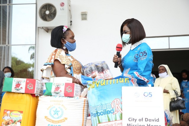 The wife of the Delta State Governor and founder O5 Initiative, Dame Edith Okowa (right) presenting food stuff to the representative of City of David Orphanage, Mrs. Angela Abiamuwe during the 2020 world orphans day celebration held in Government House, Asaba