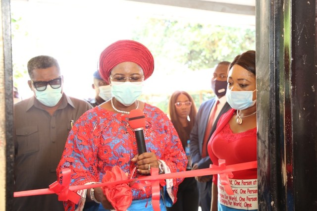 The wife of the Delta State Governor and founder O5 Initiative, Dame Edith Okowa (Middle) cutting the tape to inaugurate Sickle cell Clinic at Akwuku-Igbo General Hospital while the Commissioner of Health, Dr. Mordi Onoye (Left) and the Director-General of O5 and Permanent Secretary ministry of Women Affairs, Mrs. Oghenekevwe Agas watch on Tuesday, November 3, 2020 (Pix: Norbert Amede)