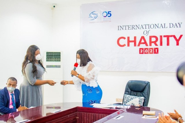 The wife of the Delta State governor and Founder O5 initiative, Dame Edith Okowa (right) presenting a cheque of N851,000 to Dr. (Mrs.) Peace Ighosewe, Chief Medical Director, Asaba Specialist Hospital, to off-set bills for indigent patient in the Hospital as part of activities marking the 2021 International Charity Day held in her office, Government House, Asaba on September 7, 2021