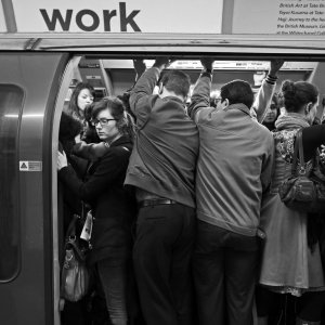 City workers cram into crowded carriage