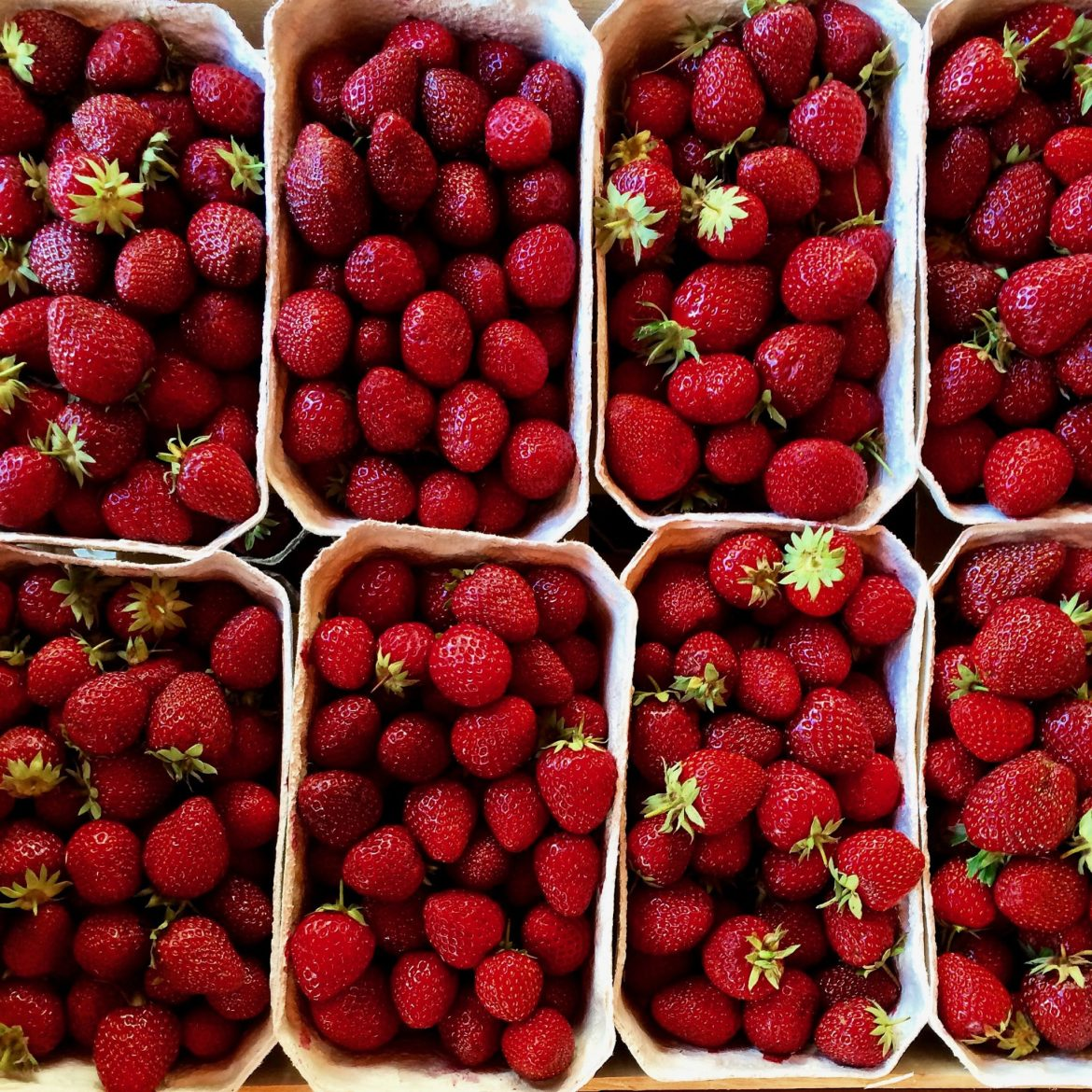 Punnets of strawberries taken from above