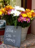 Flowers and a bakery sign for macarons