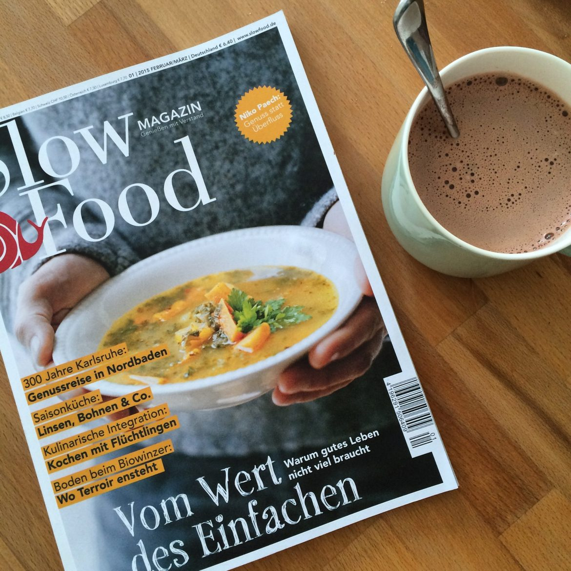 Slow Food magazine and a hot chocolate