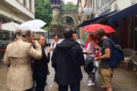 People standing with umbrellas on Am Römertor Wiesbaden