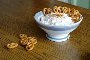 A bowl of Spundekäse with pretzels