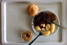 German hospital food on a tray: Frikadelle with potatoes and braised red cabbage