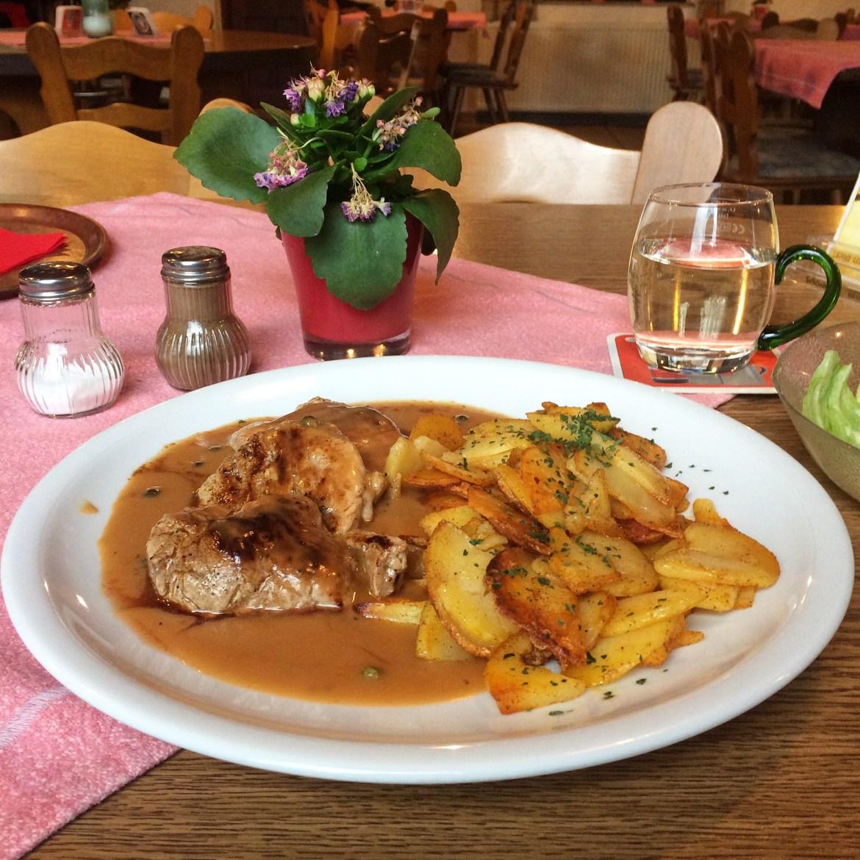 A plate of Schweinelenden in Pfefferrahmsosse | pork fillet in a pepper sauce