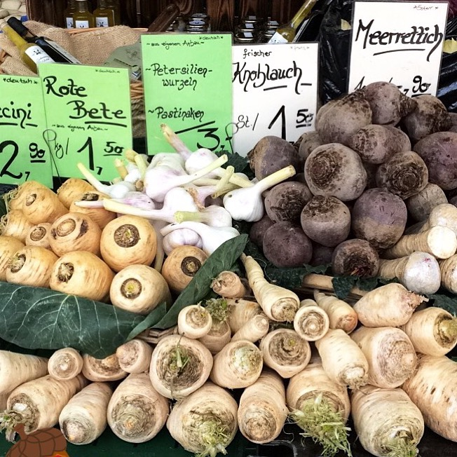 A farmers' market stand of winter root vegetables