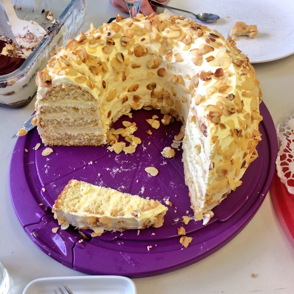 A partially-eaten Frankfurter Kranz on a purple cutting board