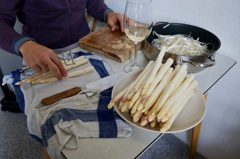 A table set up for white asparagus peeling