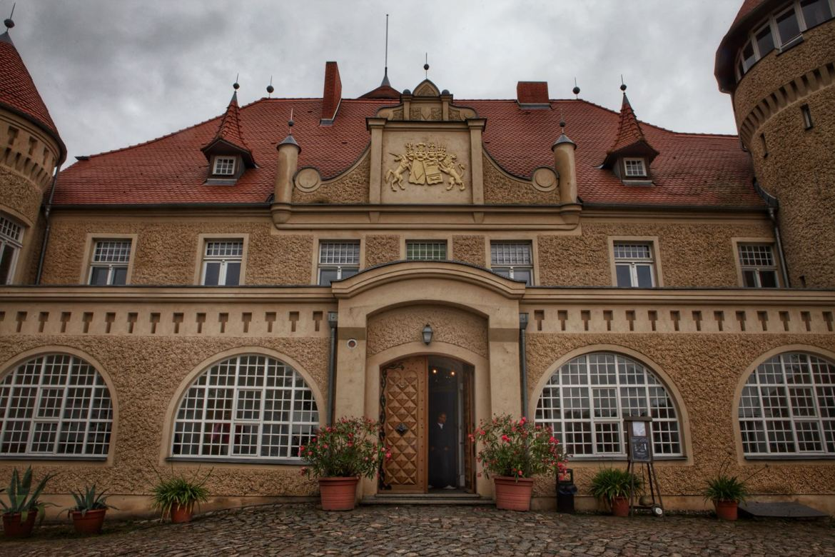 The red roof and pale stone frontage of Schloss Stolpe non Usedom
