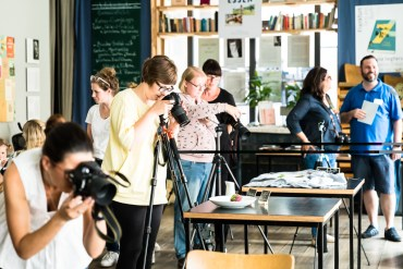 Photographers taking pictures of food in a restaurant in Frankfurt