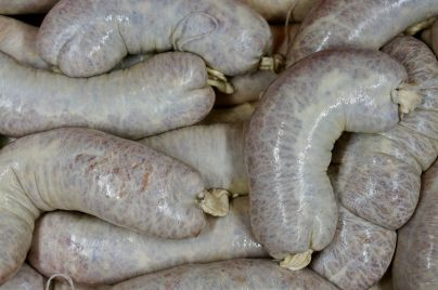 Close up of raw garlic sausages
