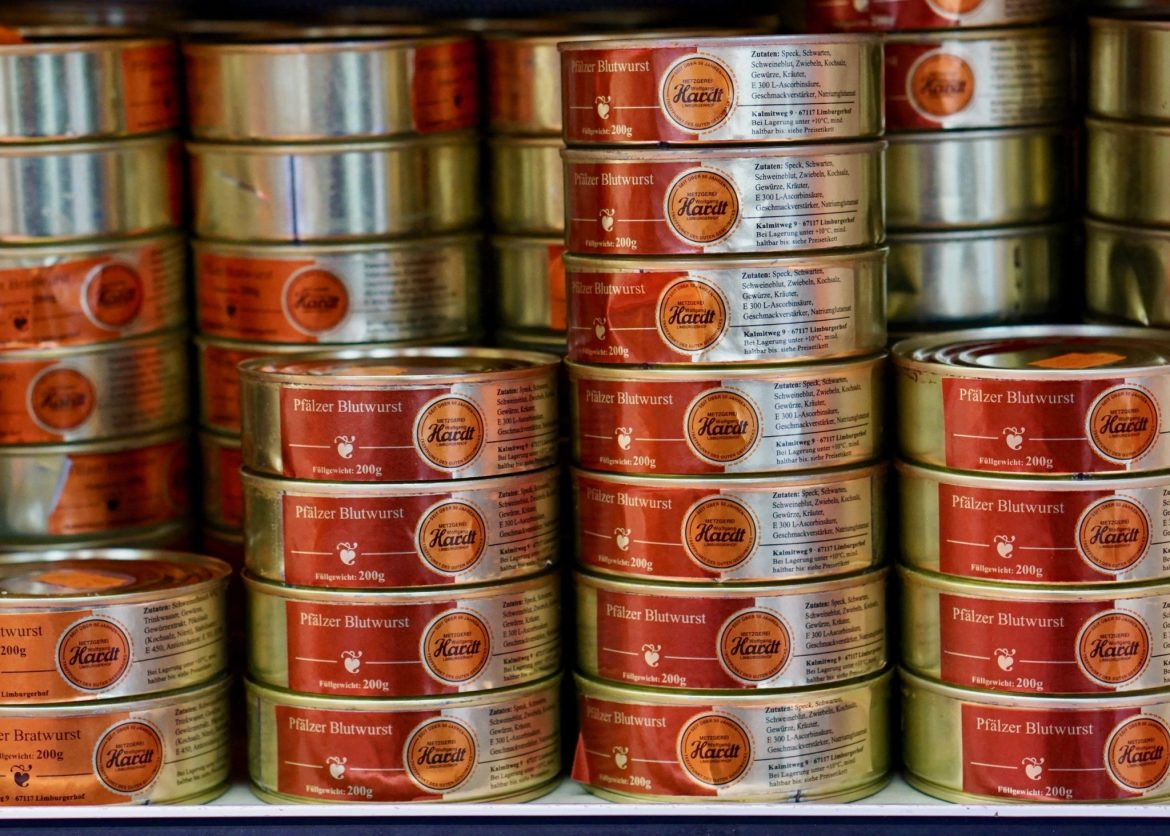 Tins of meat stacked seven-high