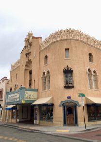 Adobe cinema with ornate roof details in Santa Fe