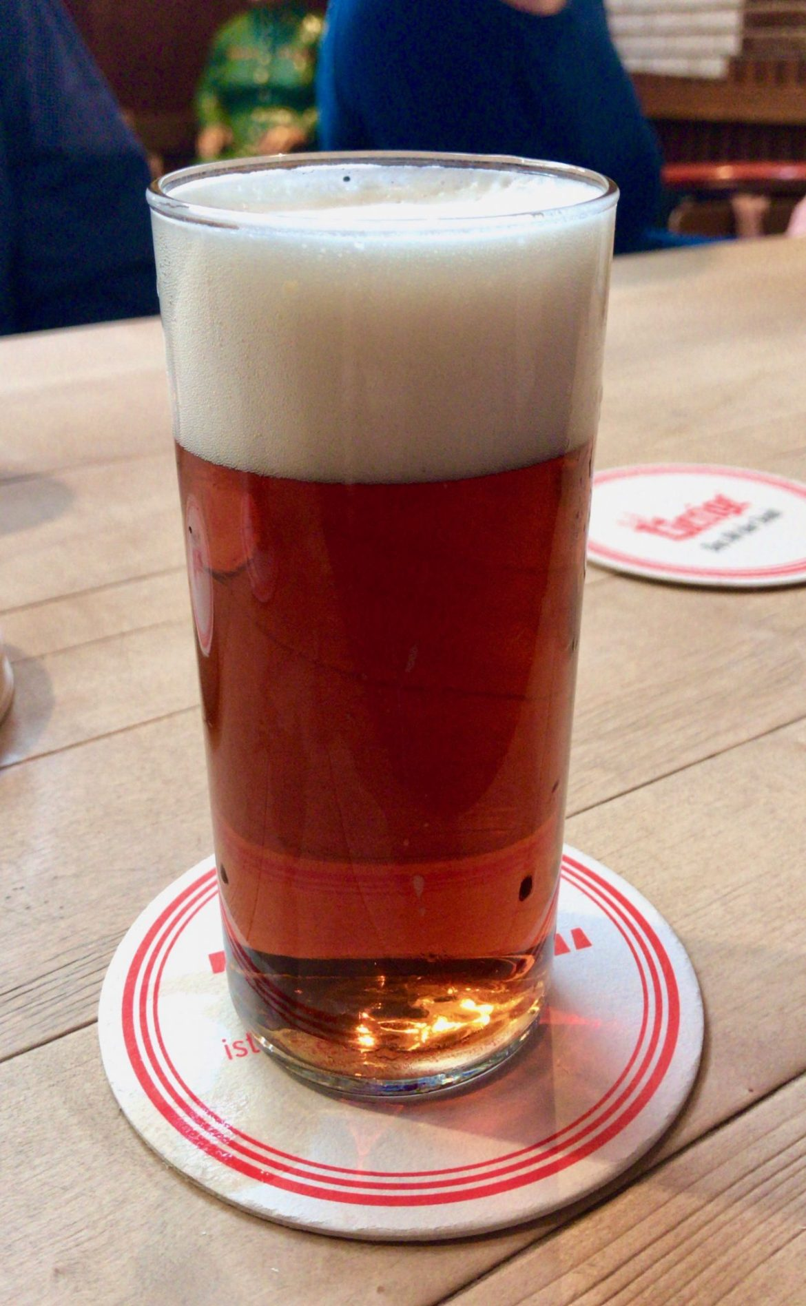 A glass of Altbier on a wooden table