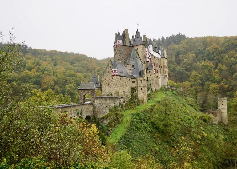 Eltz castle taken from the side, surrounded by forest