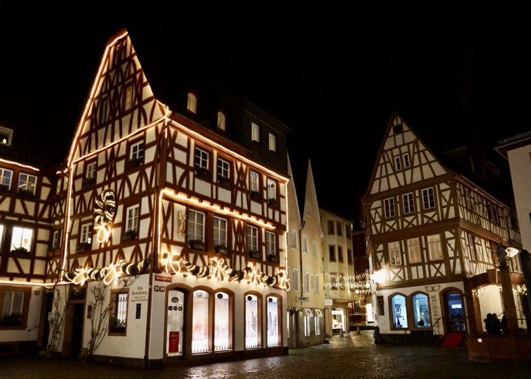 Half-timbered buildings decorated in Christmas lights
