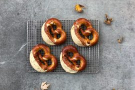 Four pretzels on a baking rack from above