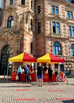 People queuing to buy white asparagus at Wiesbaden farmers market