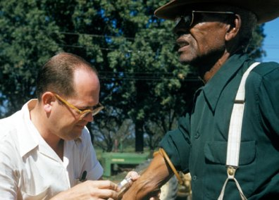 Photo of Tuskegee study subject having blood drawn.