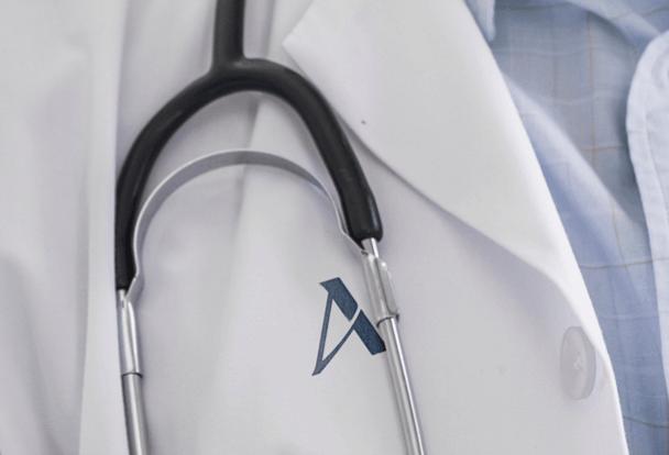 Close up of Ascendant Detox center New York City doctors coat