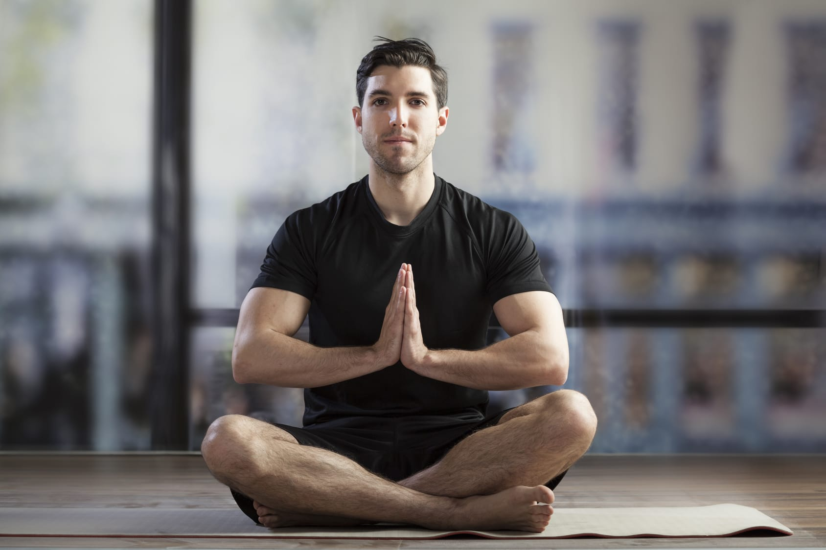 young man doing yoga holistic recovery at ascendant new york