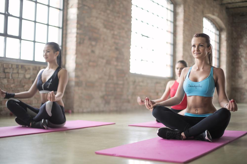 a photo of a group of ladies doing yoga, yoga for addiction treatment, benefits of power yoga for addi, yoga for addiction recovery, addiction treatment, drug addiction treatment, drug addiction tre