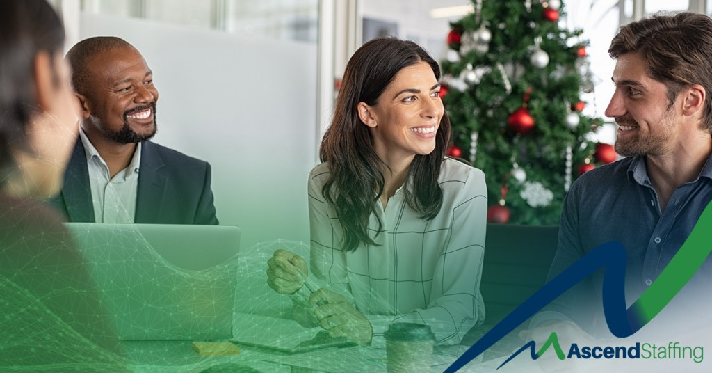 People in a Business meeting with Christmas tree in the background