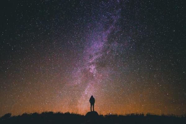 Person under night sky with milky way
